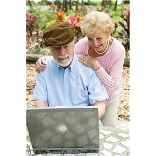 Elderly couple at laptop