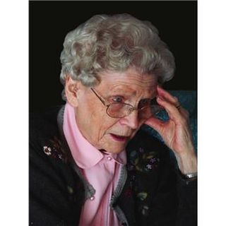Elderly woman with hand to head