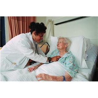 Old woman in hospital bed