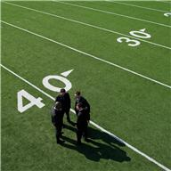 Business people on football field