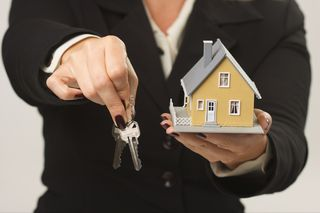 House with keys being handed