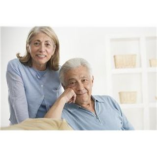 Elderly couple posing together