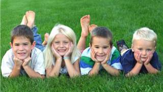 Kids posing on grass -cut