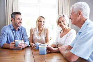 Parents adult children talking at table - From PFL