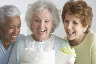 Elderly with birthday cake - longevity